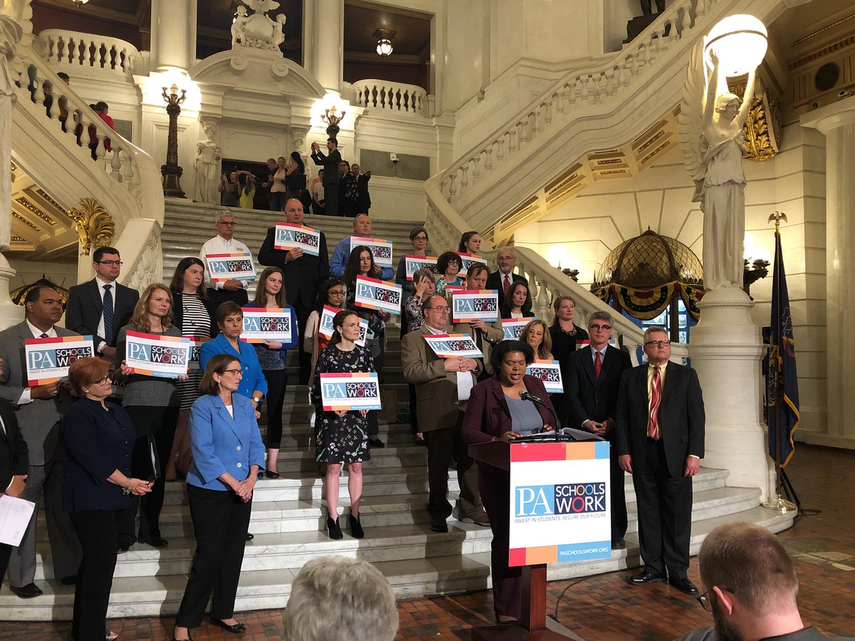 Educators stand on the steps in the Pennsylvania capital after increasing state education funding